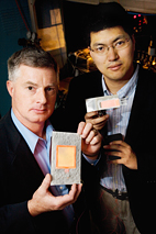Gary Eden, professor and director of the Laboratory for Optical Physics and Engineering, left, with Sung-Jin Park, visiting professor and research scientist in electrical and computer engineering, hold flat-panel lamps made with aluminum foil and tiny plasma arrays their team developed.