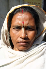 Scorned Hindu widows, such as this woman in Vrindivan, are sometimes turned out of their homes and have few economic options other than begging for an ashram.