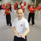 Visiting kinesiology professor Yang Yang leads a group of residents of Clark Lindsey Village in Urbana in Qigong and Taiji. Yang has found that healthy seniors who practiced a combination of Qigong and Tai Chi three times a week for six months experienced significant physical benefits after only two months.