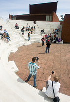 Simon Levin, left in foreground, and U. of I. professor Kevin Hamilton document a student presentation in the amphitheater outside the Krannert Center for the Performing Arts.