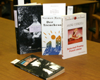A few of the rare titles of poetry, fiction, non-fiction and journals that prolific writer and radio essayist Andrei Codrescu gave the U. of I. Library are shown. Most of the materials are in Romanian and many are rare and were produced by small publishing houses.