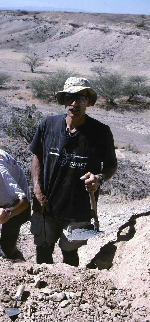 Anthropologist Stanley Ambrose collects fossil soils, armed with his trowel, hammer and folding army shovel, from the area where the new Ardipithecus remains were found.