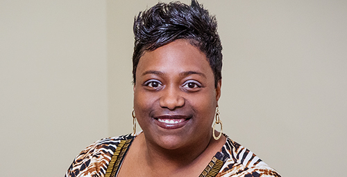 "Donyetta Turner, a staff clerk for the department of agricultural and consumer economics, spends much of her workday communicating with customers who have ordered a popular U. of I. tax workbook. Ensuring everything is delivered in the wintertime can be fraught with headaches. She said having a good team alongside her makes the job easier. ""We're a small team but a good team,"" she said.  Click photo to enlarge"