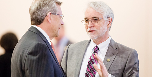 Marching on Though U. of I. President Bob Easter will retire at the end of the semester, his replacement, Timothy R. Killeen, right, has spent the last several months speaking with campus groups and making transition plans, and he was involved in the recommendation for the Urbana medical school. Killeen speaks here with Edward L. McMillan, the new chairman of the U. of I. Board of Trustees, at the board's March 12 meeting in Urbana.  Click photo to enlarge