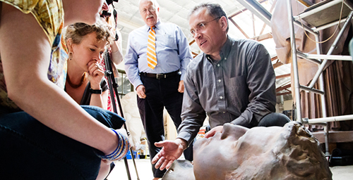 Head games Andrzej Dajnowski, the lead conservator with Conservation of Sculpture and Objects Studio, Forest Park, Ill., explains the disassembly process to a team from the U. of I. that is following the status of the work. Further work has shown that the Alma Mater statue actually comprises 48 pieces and was kept together with nearly 1,000 bolts and fasteners. The repaired statue is expected to return to campus in time for commencement 2014.  Click photo to enlarge