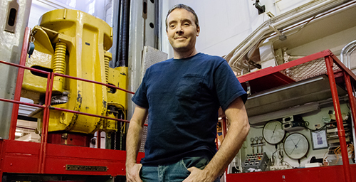 Meet the press Greg Milner, the research lab shop supervisor for the department of aerospace engineering, stands in front of the U. of I.'s universal testing machine - a giant press that can exert 3 million pounds of force, either for pushing or pulling an object to test its failure load.  Click photo to enlarge