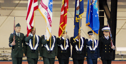 Unflagging loyalty The Illinois ROTC color guard keeps in step during a Veteran Day's ceremony held Nov. 11 at the Armory. UI's connection with the military runs deep, with ROTC classes first offered in 1868 as one pillar of the university's land-grant mission responsibilities.  Click photo to enlarge
