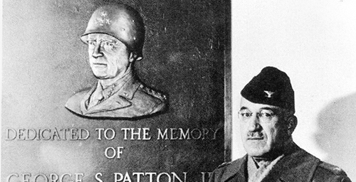 In memory Col. Oscar Koch poses before a plaque honoring his former commander, Gen. George S. Patton Jr., following the dedication of Patton Hall at Fort Riley in 1946. Koch was the head of the Armys intelligence school at Fort Riley.  Click photo to enlarge