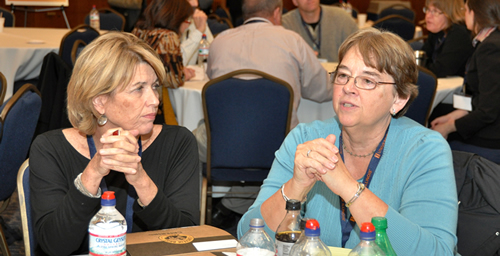 "At left, Mary Ellen O'Shaughnessey, executive assistant dean for the College of Fine and Applied Arts, listens while Sandra Goss Lucas, a professor of psychology, makes a point during roundtable discussions at the ""Summit on Online Education: The Present and Future"" on Oct. 31. The discussions were designed to identify barriers to improved online education integration and to offer localized solutions.  Click photo to enlarge"