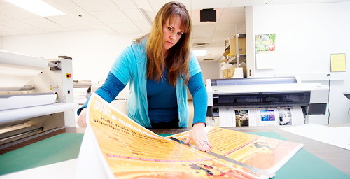 "Pre-press technician Elizabeth Bowden prepares an order at the UI's Document Services department. Barbara Childers, the department's director and Facilities and Services associate director, said the department will continue to offer most of its traditional day-to-day services - though not the higher-volume work such as letterpress printing, large offset production and some bindery functions. ""By eliminating the services that we did, we now can be a more effective, one-stop provider,"" Childers said."