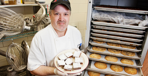 "UI pastry chef Curtis Nesler has been perfecting his craft for the past 30 years, the last three in a University Housing kitchen. He says the staff here adheres to the highest of quality standards and won't send out food - cupcake or cruller - unless it's just right. ""If it takes an extra step or we have to put a little extra 'polish' on it, then we'll do it,"" he said. ""Everyone here has an immense amount of pride in their work.""  Click photo to enlarge"