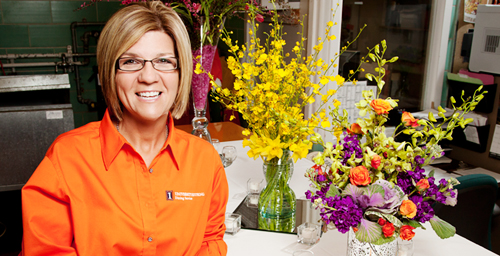 Tammie Lawson, a UI floral designer for 12 years, has been arranging flowers for most of her adult life. She works for University Catering as well as contracted events such as weddings. After one use, most flowers are kept in storage and reused for other campus events. Lawson said she is constantly on the lookout for new and better floral varieties  preferably in orange and blue.  Click photo to enlarge