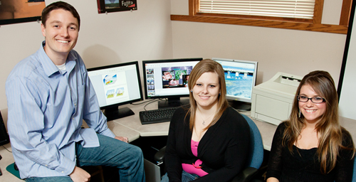 Eric Snodgrass, left, a professor of atmospheric sciences, received assistance from two students in his department while adapting his course to assist two blind students. Sophomore Jacqueline Costello, left, and junior Zaneta Gacek asssisted Snodgrass on the project by writing descriptions of many of the images used in the course.
