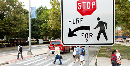 New signage was added at 29 campus crosswalk locations over the summer to reflect the state's year-old crosswalk law. Under the new law, motorists must come to a complete stop if a pedestrian has already entered a crosswalk. Pedestrians also are required to give motorists ample time to slow down and stop - or wait for a better opportunity to cross.  Click photo to enlarge