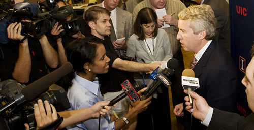 Christopher Kennedy talks with reporters after being elected chair of the UI Board of Trustees during the board's Sept. 10 meeting at the Illini Union.