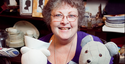 Jean Huddleston displays two bears, which she sews as keepsakes for people whose loved ones have died or donates to children in need. Huddleston, who retired April 30 as director of business and operations at Krannert Center for the Performing Arts, has sewn 563 of the bears during the past several years from clothing, tablecloths, handkerchiefs, blankets and other personal possessions of the deceased.  Click photo to enlarge