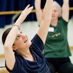 Kate Kuper, a visiting lecturer in the department of dance, leads Dance for Parkinson╒s class participants in seated exercises. Kuper said the aesthetic workout promotes a sense of self.