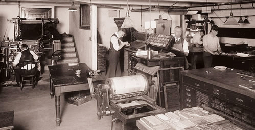Employees work in the Print Shop in the basement of the Henry Administration Building circa 1919. The 92-year-old unit, which was originally part of the UI Press and is now part of Facilities and Services, is slated for closure by June 30, 2012.