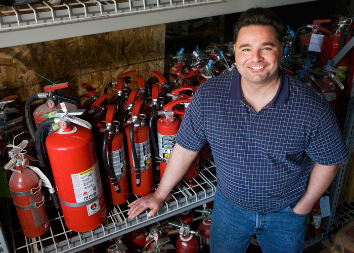John Rhoades is a safety officer in Facilities and Services. He is responsible for tracking, inspecting and arranging for maintenance and replacement of te thousands of fire extinguishers across campus.