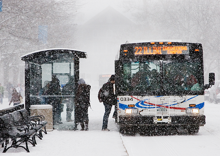 Passengers board an MTD bus at the Transit Plaza on Wright Street during a Feb. 6 snowstorm that dropped 4 1/2 inches of snow on Champaign-Urbana. A week later, a blizzard dumped an additional 13 inches of snow. High winds and blowing snow made streets and sidewalks impassable, prompting the UI to cancel classes for the first time since 1979.
