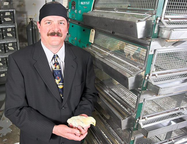 Chet Utterback - known to some as 'Chet the Chicken Man' - is foreman of the campus poultry farm.