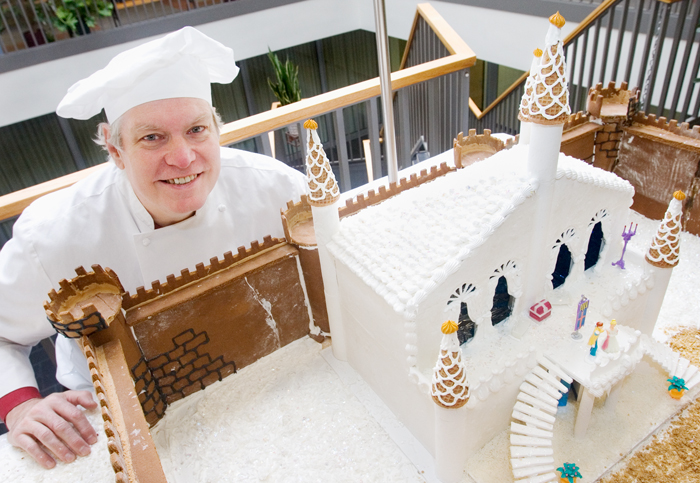 """Tom Austin is a cook in the Housing Division. Some might think he's a combination of a children's show host and a celebrity chef. """"My favorite thing is telling stories,"""" said Austin."""