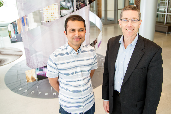 Carl R. Woese Institute for Genomic Biology faculty members Saurabh Sinha, a professor of computer science, left; and Gene Robinson, a professor of entomology and IGB director; and their colleagues warn that genomics data will likely surpass other big data in scale.