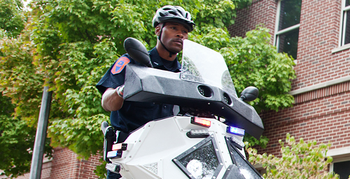 UI Police Officer James Carter demonstrates one of the new Sentinel transportation devices, which the department started using on the Urbana campus for the first time this fall. UIPD officers are using two Sentinels for basic patrol and crowd-control work, while students will be using them for the Safewalks program.