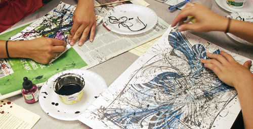 "Working with the theme ""In My World I See "" students reveal their inner landscapes using string painting, a technique in which the artist dips a piece of string 10 to 12 inches long in India ink then presses, drags or swirls the string across the paper. Color is then added using pastels, crayons or watercolors."