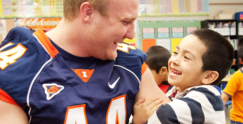 Austin Teitsma, a sophomore from Glen Ellyn, Ill., plays with a Garden Hills Elementary School student during a Hometown Heroes visit.