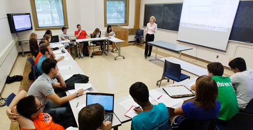 The design of this classroom, being used by rhetoric professor Cheryl Price, gives students plenty of laptop space and brings them closer together duirng more interactive exercises.