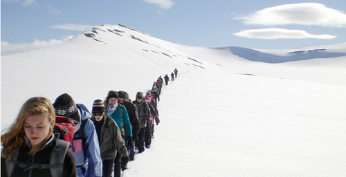 Class crosses Larsbreen Glacier in Svalbard, Norway.