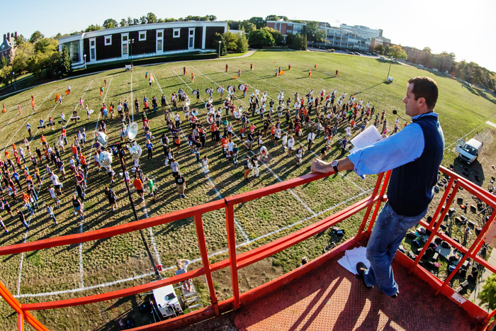 Band director Barry Houser supervises the Marching Illini last fall from a rented scissor lift overlooking the field north of Krannert Art Museum, one of the bands two unofficial campus practice locations.