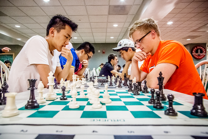 Chess Club members Bo Schmidt, right, a senior in physics, plays against Benson Wang, a freshman in electrical and computer engineering, in the food court of the Illini Union.