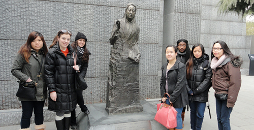 The Illinois group  from the left, Kristin Wang, Riley Wharton, Jenna Kandah, Anny Chang, Kayla Bell, Cheryl de Guzman and Megan Lee  at the statue of the late 1989 U. of I. alumna Iris Chang in the Nanjing Massacre Memorial Hall in Nanjing. Changs best-selling book The Rape of Nanking: The Forgotten Holocaust of World War II was published in 1997 on the 60th anniversary of the Nanking Massacre.