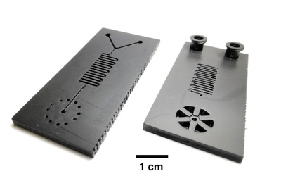 Top and bottom views of a microfluidic cartridge
