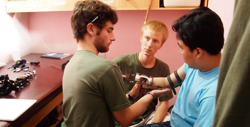 Jonathan Naber, left, and Adam Booher fit the first amputee patient with one of three prototypes Illini Prosthetic Technologies tested on a trip to Guatemala in July 2010.