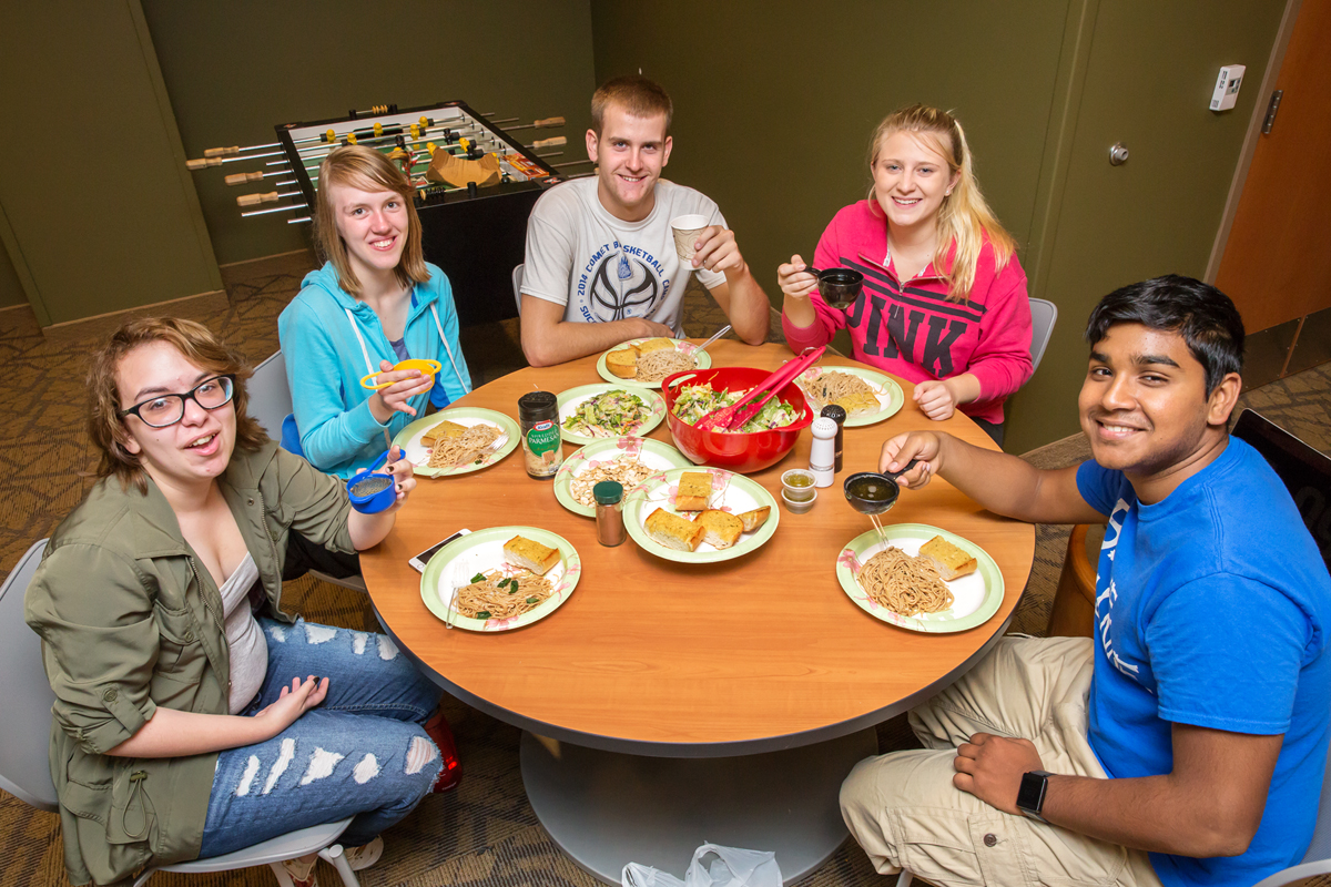 "Students prepared a meal as part of Jamie Jones' Grand Challenge course, ""Fictions of Sustainability."" Through classic literary narratives, students follow the pathway that food takes to the table, as well as the social and environmental impact it has on society. The students are, from left: Nora Pinkowski, April Wendling, Thomas Wellborn, Claire Bollinger and Pranav Perepa."