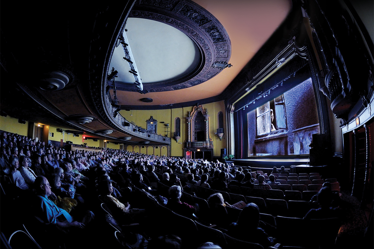 The audience takes in the film Life, Above All at the 2011 Ebertfest, in the Virginia Theatre in downtown Champaign, Illinois. The 2016 festival will be held April 13-17.