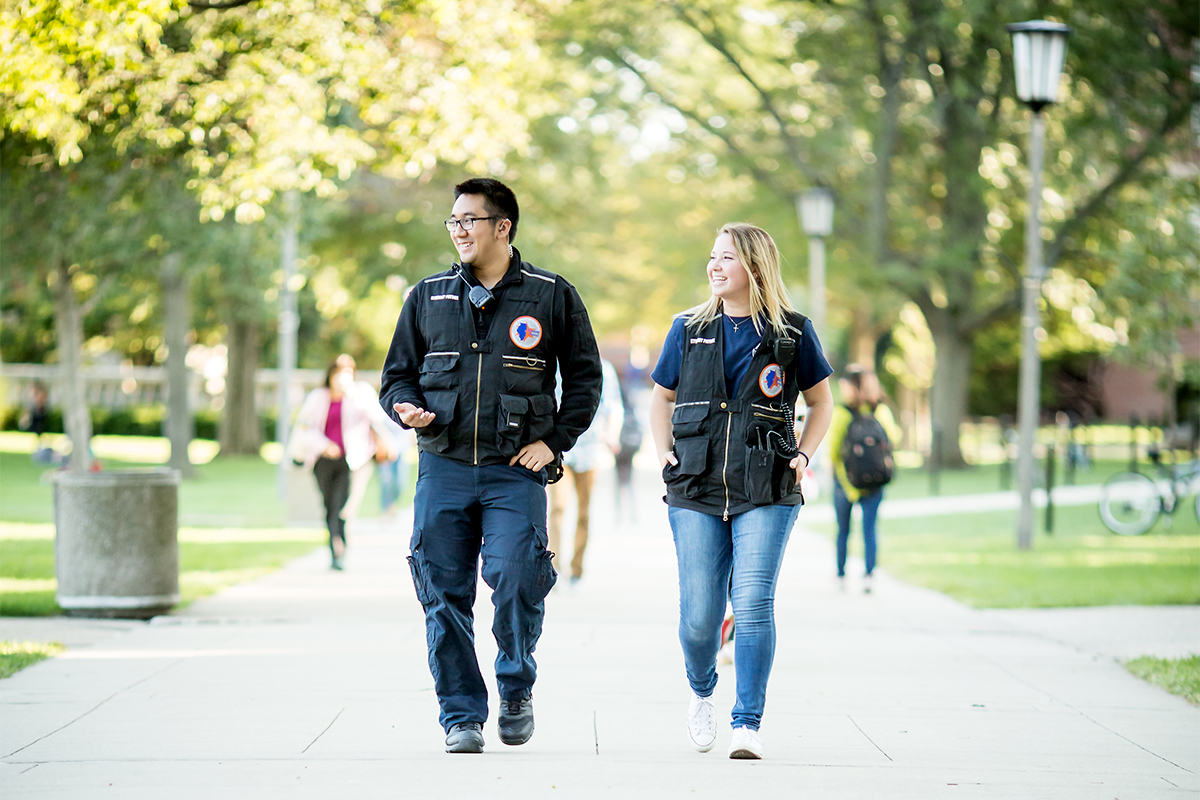 Alex Tran and Angela Annarino are members of the U. of I. Student Patrol, a team of trained students who provide campus safety services.