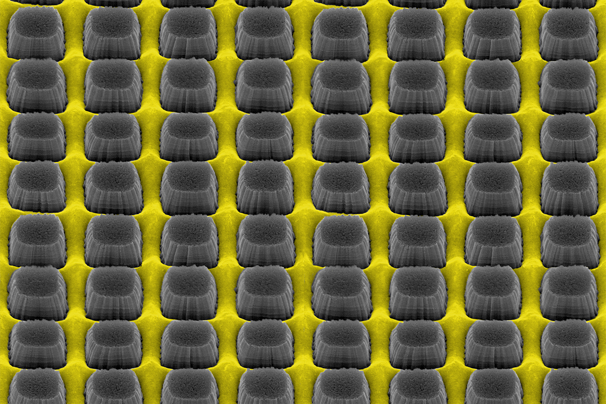 An array of nanopillars etched by thin layer of grate-patterned metal creates a nonreflective surface that could improve electronic device performance.