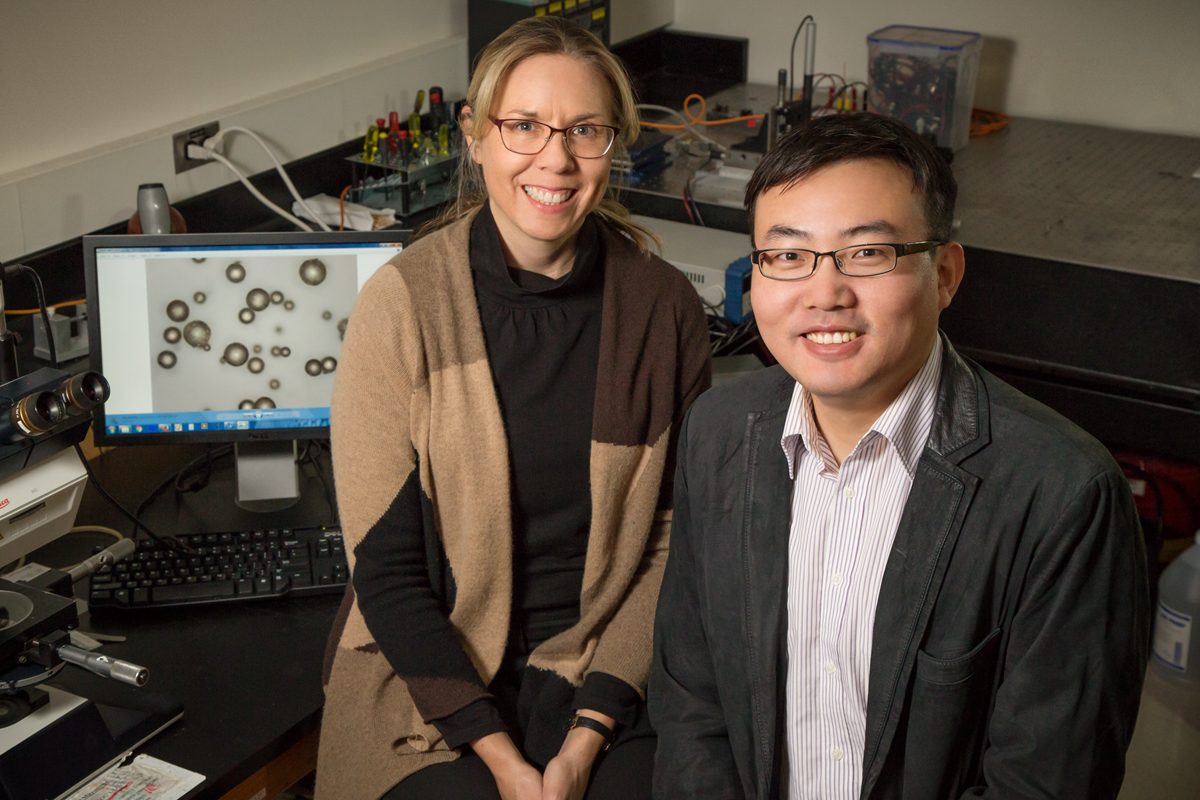 Illinois professor Nancy Sottos and postdoctoral researcher Wenle Li led a team that developed color-changing indicators to highlight microscopic cracks in structural materials.