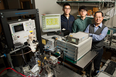 University of Illinois engineers developed fiber-optic technology that can transmit data at a blazing-fast 57 gigabits per second, without errors. Pictured are graduate students Curtis Wang and Michael Liu with professor Milton Feng.