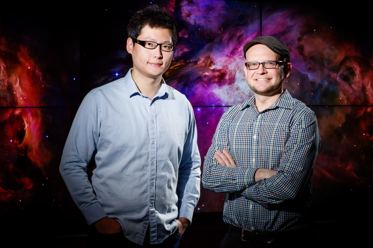 MEteor, an interactive computer simulation, teaches middle school students about gravity and planetary motion in an immersive, whole-body environment. From left, doctoral student Shuai Wang and Robb Lindgren, a professor of educational psychology and of curriculum and instruction, found in a recent study that the astronomy games whole-body learning activities were linked with significant learning gains, greater student engagement and more positive attitudes toward science.