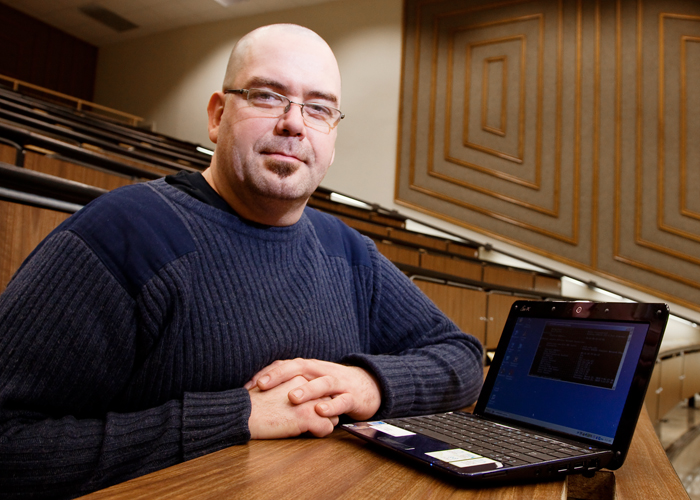 LAN support specialist Michael Hallihan is a self-described anti-geek who manages technology needs for the College of Medicine by day and abandons computers by night, when he spends more time working on his house or cooking for his family.
