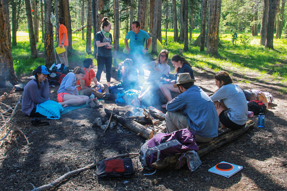 U. of I. students did some experiential learning in the Yellowstone and Grand Teton parks this June in a course on the politics and other issues surrounding national parks. Here the class relaxes before a campfire dinner and discussion.