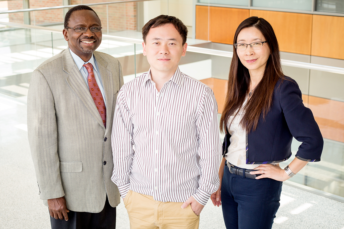 Illinois researchers developed a method to etch tall, thin transistors for high performance with less error. Pictured, from left: professor Ilesanmi Adesida, graduate student Yi Song and professor Xiuling Li.