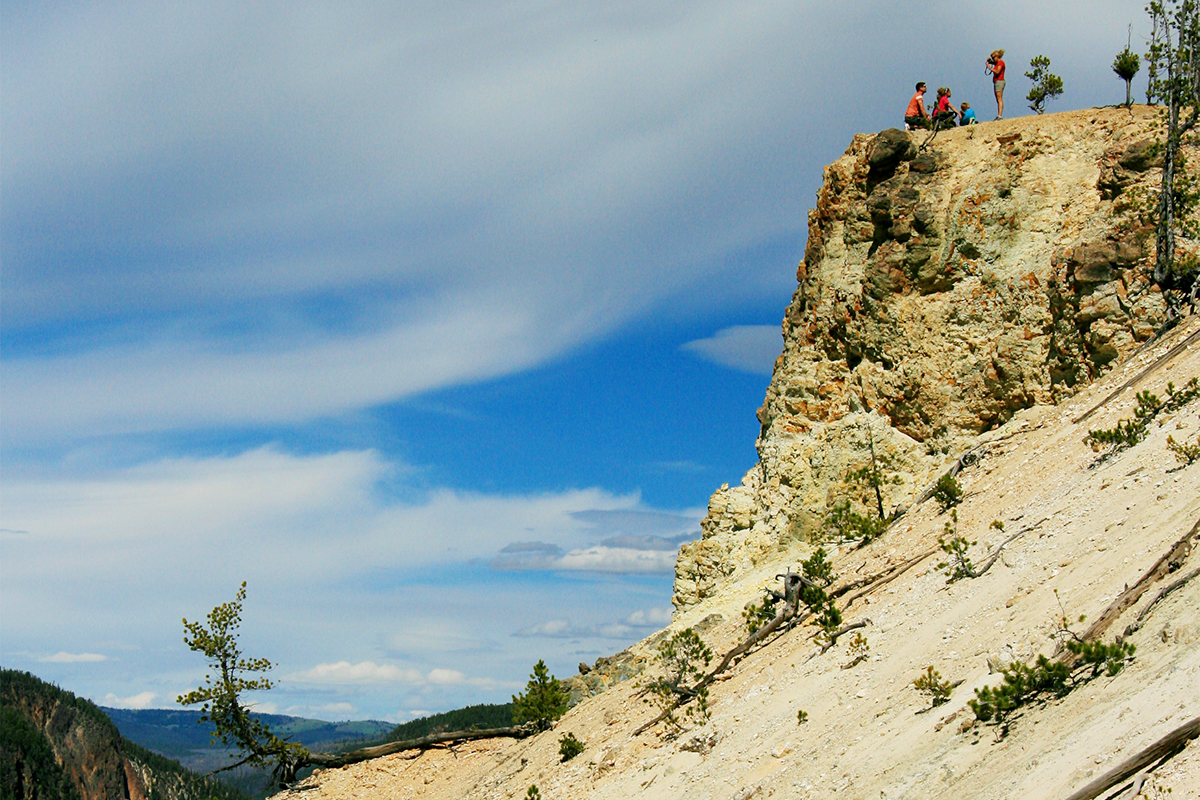"Students learned about the politics and other issues surrounding the national parks through an on-site course this June in the Greater Yellowstone area. One day's ""sampler"" hike gave students a chance to witness several examples of unwise behavior, including these tourists hanging out on the edge of the Grand Canyon of the Yellowstone."
