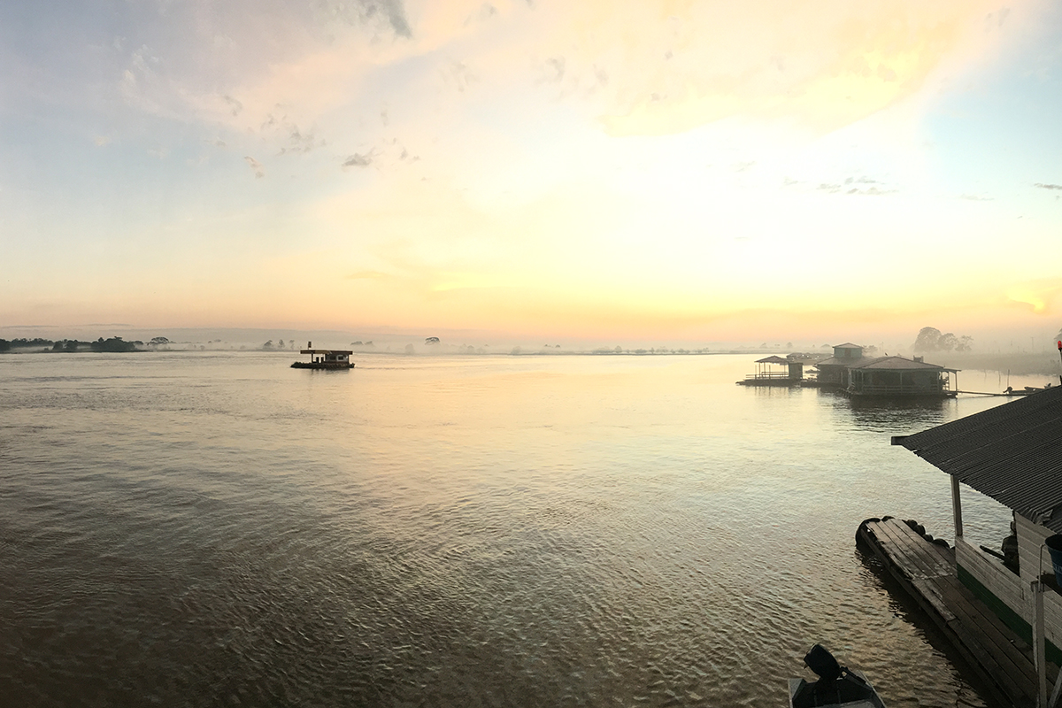 Sunrise breaks through the mist on the banks of the Solimões River, better known as the Amazon.