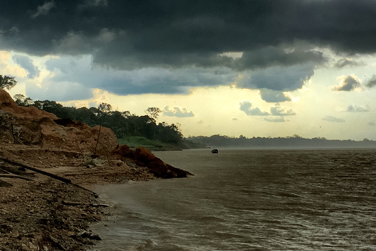 An afternoon storm passes over the river banks we were examining, halting field work for a while.